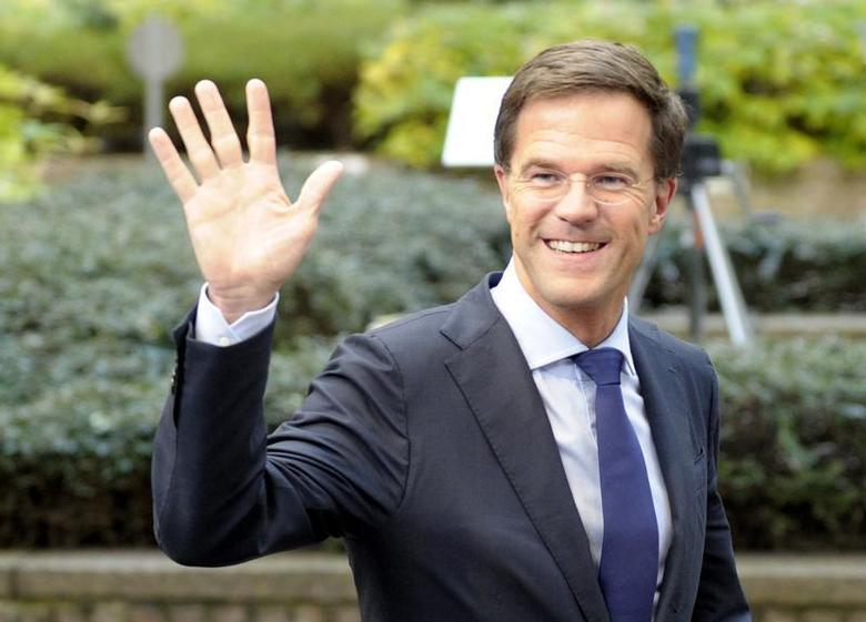 The Netherlands' Prime Minister Mark Rutte waves to the media upon arriving at a European Union leaders summit at the EU council headquarters in Brussels December 19, 2013. REUTERS/Laurent Dubrule