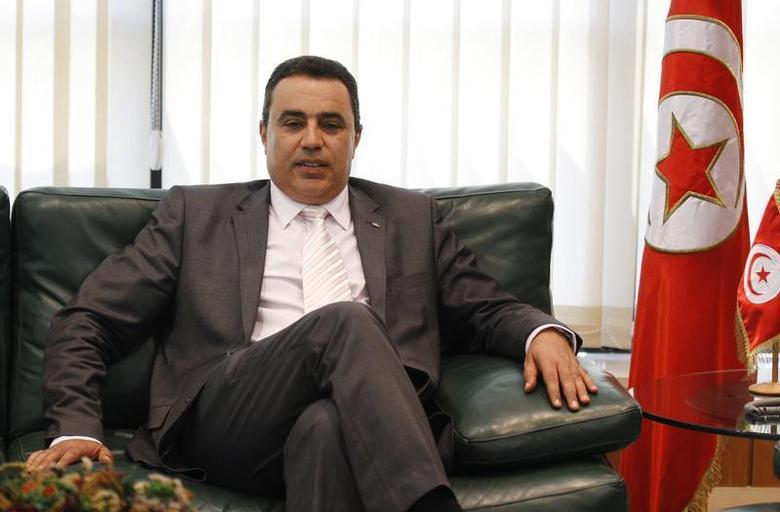 Tunisia's Industry Minister Mehdi is pictured in his office in Tunis in this June 25, 2013 file photo. REUTERS/Anis Mili/Files