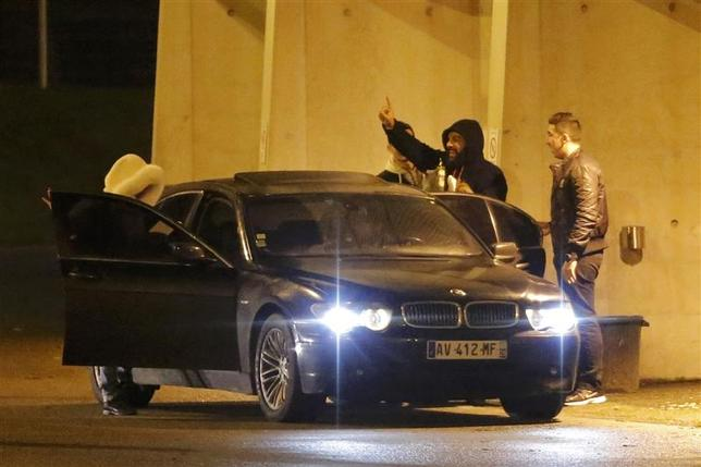 French humorist Dieudonne M'bala M'bala (2ndR), also known as Dieudonne, waves to fans as he leaves the Zenith concert hall where he was to hold his show in Nantes, January 9, 2014. REUTERS/Stephane Mahe