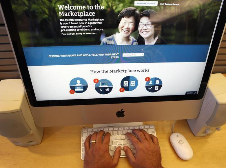A man looks over the Affordable Care Act (commonly known as Obamacare) signup page on the HealthCare.gov website in New York in this October 2, 2013 photo illustration. REUTERS/Mike Segar