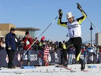 Todd Lodwick of the United States stamps on the finish line with his skis to come in first during the U.S. Olympic nordic combined trials at Utah Olympic Park. Mandatory Credit: Nathan Bilow-USA TODAY Sports