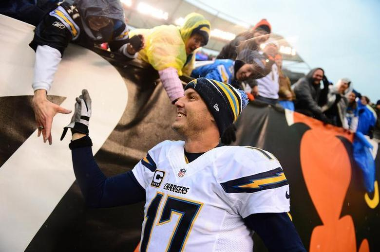 San Diego Chargers quarterback Philip Rivers (17) celebrates with fans after defeating the Cincinnati Bengals 27-10 to win AFC wild card playoff football game at Paul Brown Stadium. Mandatory Credit: Andrew Weber-USA TODAY Sports