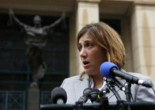 Marla Diaz, attorney for the Baltimore Museum of Art, speaks to the media outside of the U.S. District Court in Alexandria, Virginia January 10, 2014. REUTERS/Gary Cameron