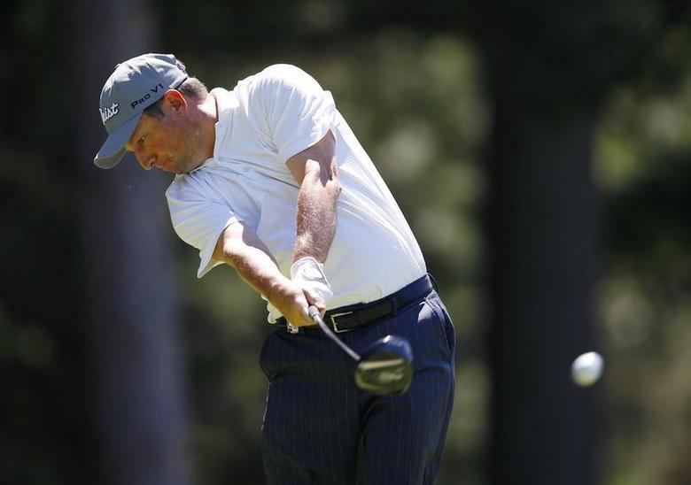 South Africa's Tim Clark hits from the 10th tee during the third round of the 2013 PGA Championship golf tournament at Oak Hill Country Club in Rochester, New York August 10, 2013. REUTERS/Jeff Haynes