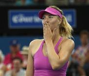 Maria Sharapova of Russia blows a kiss to the crowd after her win against Kaia Kanepi of Estonia during their women's singles match at the Brisbane International tennis tournament in Brisbane, January 2, 2014. REUTERS/Jason Reed