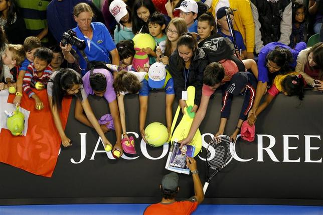 Rafael Nadal of Spain signs autographs for fans during the Kids Tennis Day before the Australian Open 2014 tennis tournament in Melbourne, January 11, 2014. REUTERS/David Gray