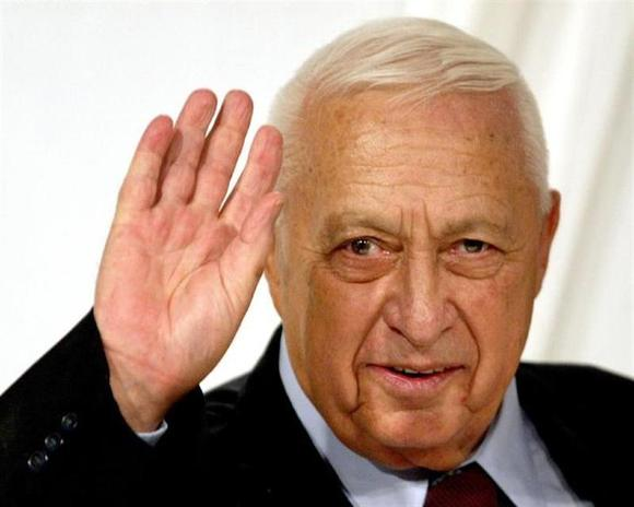 Israeli Prime Minister Ariel Sharon gestures at the end of his Likud Party's women conference in Tel Aviv in this March 10, 2005 file photo. REUTERS/Files