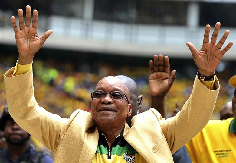 South Africa's President and leader of the ruling ANC party Jacob Zuma (C) greets his supporters as he arrives for the launch of his party's election manifesto at Mbombela stadium in Nelspruit January 11, 2014. REUTERS/Ihsaan Haffejee