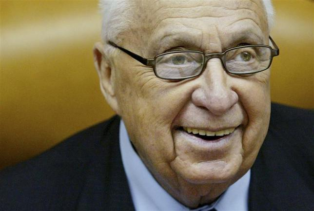 Israeli Prime Minister Ariel Sharon smiles as he speaks during the weekly cabinet meeting at his Jerusalem office in this January 2, 2005 file photo. REUTERS/Kevin Frayer/Pool/Files