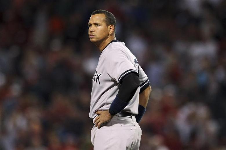 New York Yankees' Alex Rodriguez stands at third base in the eighth inning of their MLB American League baseball game against the Boston Red Sox in Boston, Massachusetts in this August 18, 2013 file photo. REUTERS/Dominick Reuter/Files