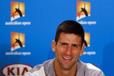 Current Australian Open champion Novak Djokovic of Serbia smiles during a news conference at the Australian Open 2014 tennis tournament in Melbourne January 12, 2014. REUTERS/Bobby Yip