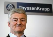 CEO of Germany's industrial conglomerate ThyssenKrupp AG Heinrich Hiesinger poses during the annual news conference at their headquarters in Essen December11, 2012. REUTERS/Ina Fassbender