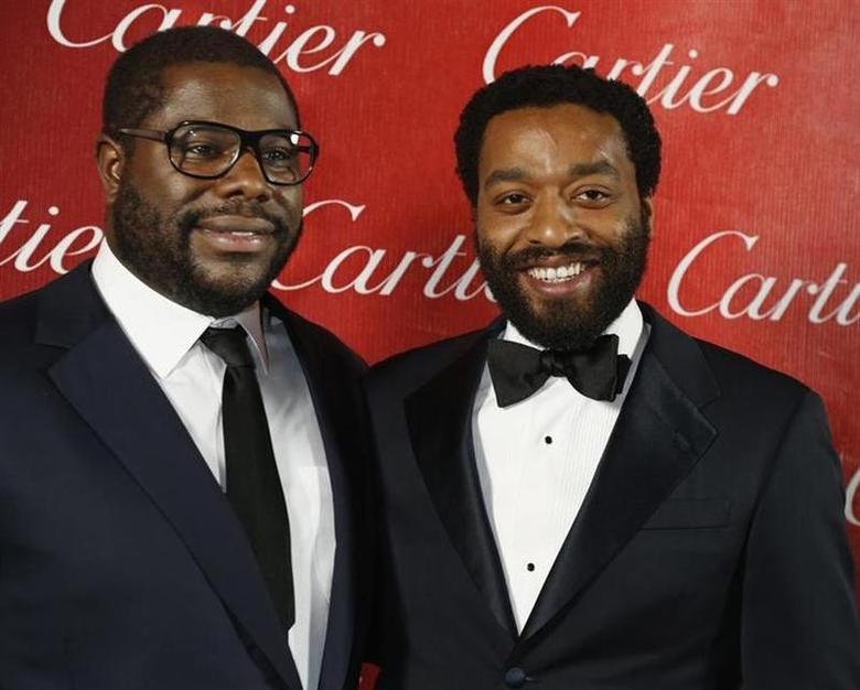 British film director Steve McQueen (L) poses backstage with the star of his film Chiwetel Ejiofor from ''12 Years A Slave'' after winning Director of the Year at the 2014 Palm Springs International Film Festival Awards Gala in Palm Springs, California January 4, 2014. REUTERS/Fred Prouser