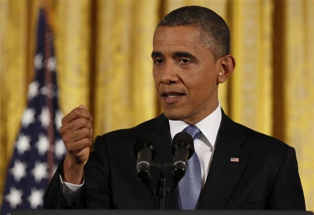 U.S. President Barack Obama gestures while addressing his first news conference since his reelection, at the White House in Washington November 14, 2012. REUTERS/Larry Downing