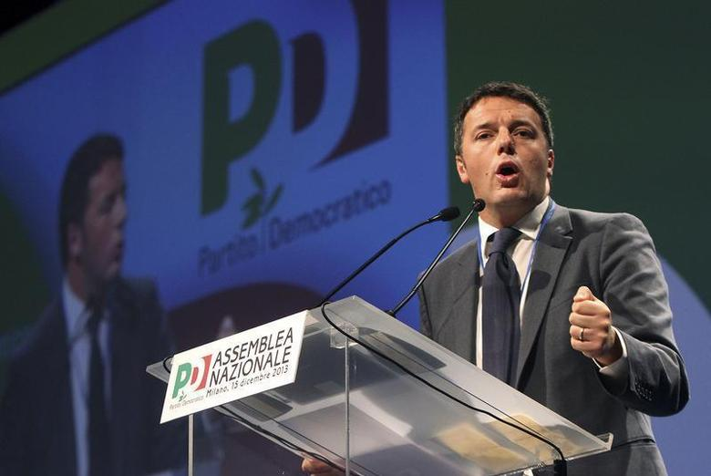 New elected center-left Democratic Party (PD) leader Matteo Renzi gestures during his first national meeting in Milan, December 15, 2013. REUTERS/Stringer