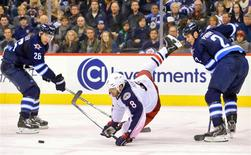 Jan 11, 2014; Winnipeg, Manitoba, CAN; Columbus Blue Jackets forward Nathan Horton (8) falls as he battles for the puck with Winnipeg Jets defenseman Adam Pardy (2) during the third period at MTS Centre. Columbus wins 6-3. Mandatory Credit: Bruce Fedyck-USA TODAY Sports