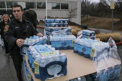 Restaurants reopen with bottled water after West...