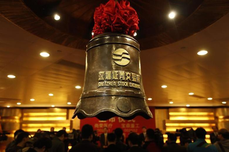 A bell bearing the logo of the Shenzhen Stock Exchange is seen during a companies listing ceremony in Shenzhen, Guangdong province February 25, 2011. REUTERS/Stringer