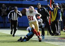 Jan 12, 2014; Charlotte, NC, USA; San Francisco 49ers wide receiver Anquan Boldin (81) is tackled by Carolina Panthers cornerback Melvin White (23) during the first half of the 2013 NFC divisional playoff football game at Bank of America Stadium. Sam Sharpe-USA TODAY Sports