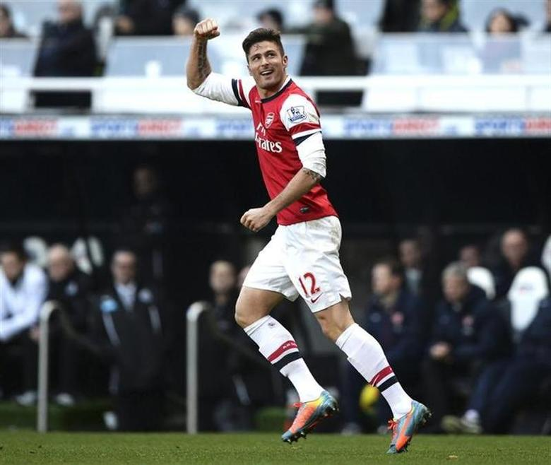 Arsenal's Olivier Giroud celebrates his goal against Newcastle United during their English Premier League soccer match at St James' Park in Newcastle, northern England, December 29, 2013. REUTERS/Nigel Roddis