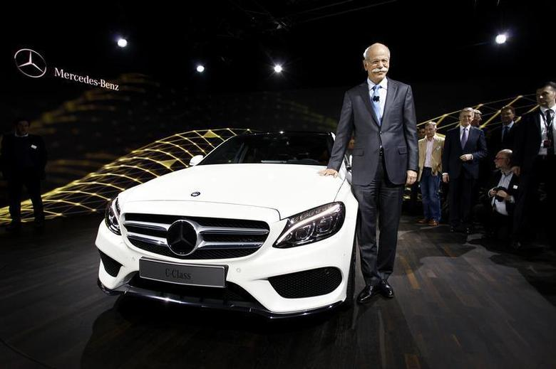 Chairman of Daimler AG and Head of Mercedes-Benz Cars Dieter Zetsche stands next to the new Mercedes-Benz 2015 C-Class during a private preview for media at the Westin Book Cadillac Hotel in Detroit, Michigan January 12, 2014, on the eve of the 2014 North American International Auto Show. REUTERS/Joshua Lott