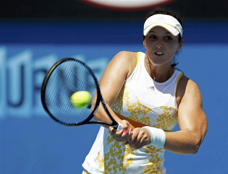 Laura Robson of Britain hits a return to Kirsten Flipkens of Belgium during their women's singles match at the Australian Open 2014 tennis tournament in Melbourne January 13, 2014. REUTERS/Brandon Malone