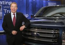 Ford Motor Co. Executive Chairman Bill Ford poses next to a Ford F150 pick-up truck during a gathering at the Ford Conference Center in Dearborn, Michigan December 12, 2013. REUTERS/Rebecca Cook