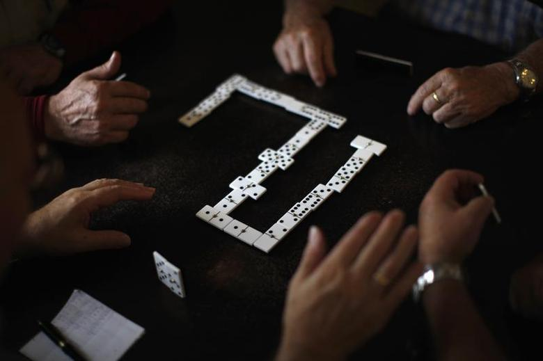 Pensioners play dominoes at a seniors centre during the International Day of Older Persons in Ronda, near Malaga October 1, 2013. REUTERS/Jon Nazca