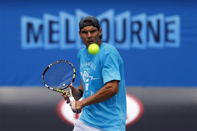 Rafael Nadal of Spain hits a return during a practice session at the Australian Open 2014 tennis tournament in Melbourne January 12, 2014. REUTERS/David Gray