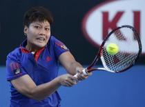 Luksika Kumkhum of Thailand hits a return to Petra Kvitova of the Czech Republic at the Australian Open 2014 tennis tournament in Melbourne January 13, 2014. REUTERS/Jason Reed
