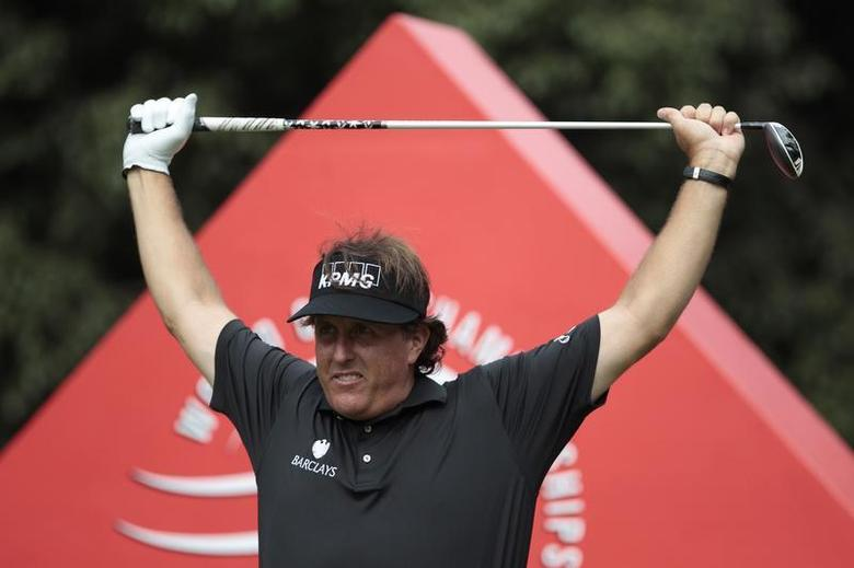 Phil Mickelson of the U.S. exercises before tees off on the 16th hole during the first round of the WGC-HSBC Champions golf tournament in Shanghai October 31, 2013. REUTERS/Aly Song