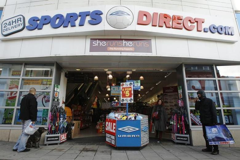 Shoppers wait outside a branch of Sports Direct in Brighton southern England December 15, 2011. REUTERS/Luke MacGregor