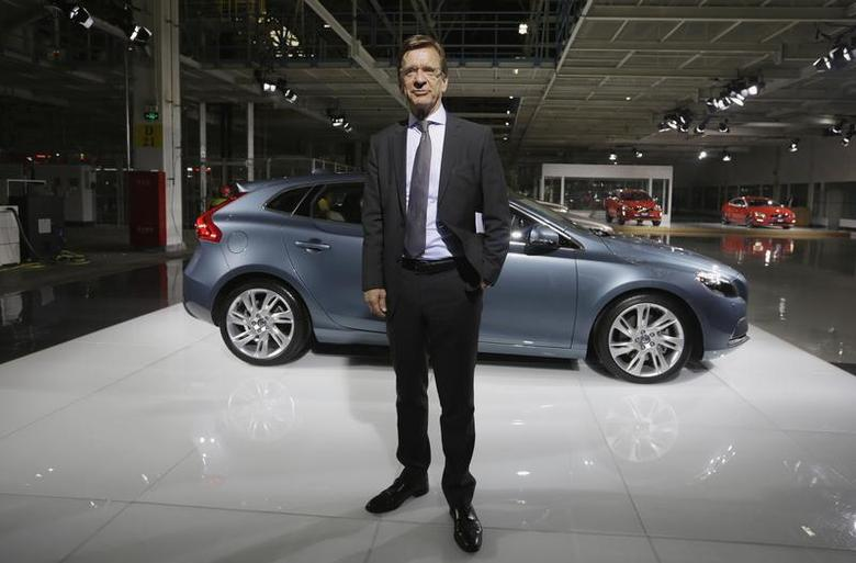 CEO of Volvo Cars Hakan Samuelsson poses for a photo next to a Volvo V40 TS car at the new Volvo automobile manufacturing plant in Chengdu, Sichuan province, June 5, 2013. REUTERS/Jason Lee
