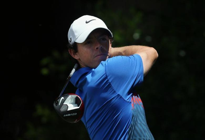 Northern Ireland's Rory McIlroy hits a shot on the seventh hole during the fourth round of the Australian Open golf tournament at Royal Sydney Golf Club December 1, 2013. REUTERS/Steve Christo
