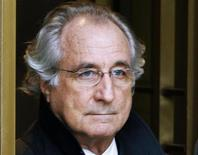 Bernard Madoff exits the Manhattan federal court house in New York in this January 14, 2009 file photo. JPMorgan Chase & Co has agreed to settle two private lawsuits stemming from its relationship with convicted Ponzi schemer Bernard Madoff, according to a court filing on January 7, 2014. REUTERS/Brendan McDermid/Files