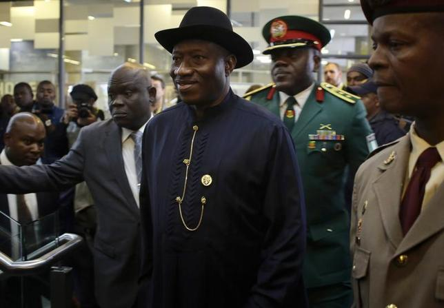 Nigeria's President Goodluck Jonathan (C) arrives for the service for former South African President Nelson Mandela at the First National Bank Stadium, also known as Soccer City, in Johannesburg December 10, 2013. REUTERS/Kevin Coombs