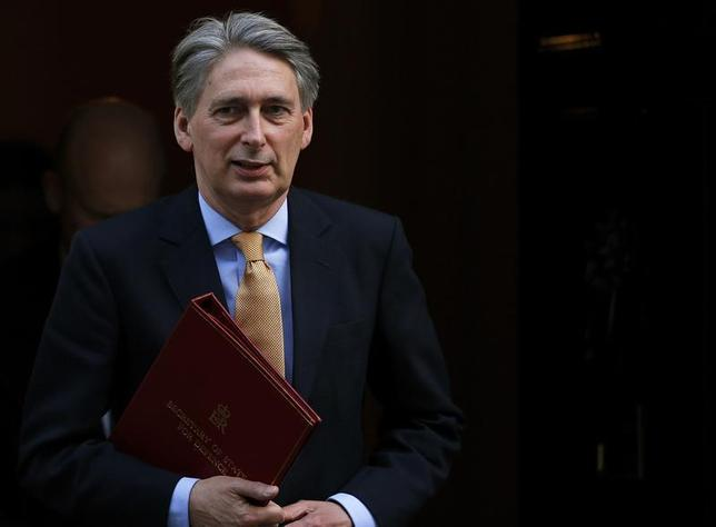 Britain's Defence Secretary Philip Hammond leaves after attending a Cabinet meeting at Number 10 Downing Street in London March 12, 2013. REUTERS/Andrew Winning