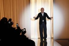 Italian designer Giorgio Armani reacts at the end of his Haute Couture Fall Winter 2013/2014 fashion show for Giorgio Armani Prive in Paris July 2, 2013. REUTERS/Charles Platiau