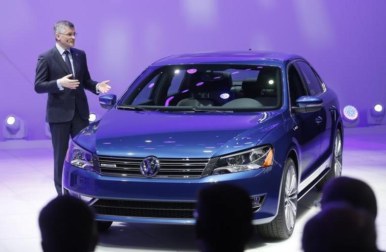 Incoming President and CEO of Volkswagen of America Michael Horn speaks next to the Passat BlueMotion during the press preview day of the North American International Auto Show in Detroit, Michigan January 13, 2014. REUTERS/Rebecca Cook