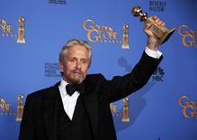 "Michael Douglas poses backstage with the award for Best Actor in a Mini-Series or TV Movie for his role in ""Behind the Candelabra"" at the 71st annual Golden Globe Awards in Beverly Hills, California January 12, 2014. REUTERS/Lucy Nicholson"