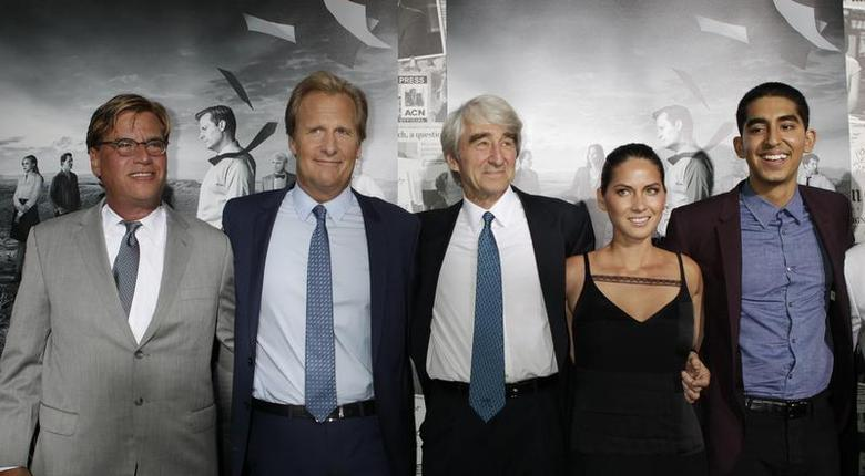 Aaron Sorkin (L), creator and executive producer, and actors Jeff Daniels (2nd L), Sam Waterston (C), Olivia Munn and Dev Patel (R) arrive for the season 2 premiere of their HBO drama series ''The Newsroom'' in Hollywood July 10, 2013. REUTERS/Fred Prouser