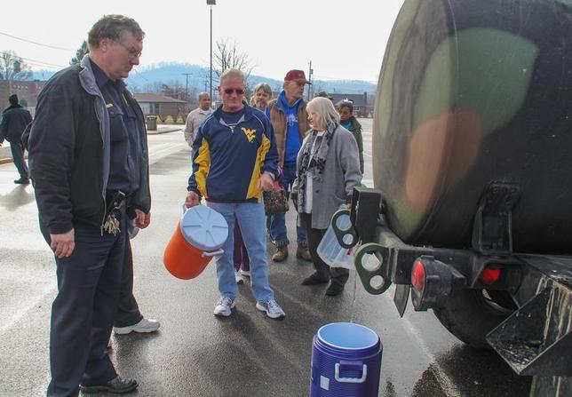 Residents line up for water at a water filling station at West Virginia State University, in Institute, West Virginia, January 10, 2014. REUTERS/Lisa Hechesky