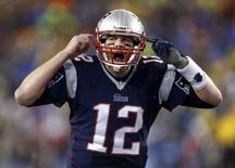 Jan 11, 2014; Foxborough, MA, USA; New England Patriots quarterback Tom Brady (12) gestures at the line in the second half during the 2013 AFC divisional playoff football game against the Indianapolis Colts at Gillette Stadium. Mandatory Credit: Mark L. Baer-USA TODAY Sports - RTX17A5F