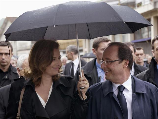 France's President Francois Hollande (R) and his companion Valerie Trierweiler take part in a march as part of a ceremony in tribute to the memory of Nazi victims in Tulle, southwestern France, in this June 9, 2012 file photo. REUTERS/Bertrand Langlois/Pool/Files