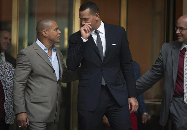 New York Yankees baseball player Alex Rodriguez (C) speaks to Fernando Mateo (L), president of Hispanics Across America, outside the Major League Baseball's (MLB) headquarters in New York October 4, 2013. REUTERS/Carlo Allegri