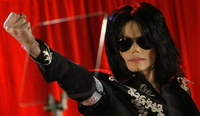 U.S. pop star Michael Jackson gestures during a news conference at the O2 Arena in London March 5, 2009. REUTERS/Stefan Wermuth