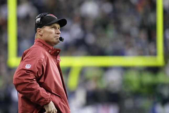 Arizona Cardinals head coach Ken Whisenhunt looks at the game clock during the fourth quarter of their NFL football game against the Seattle Seahawks in Seattle, Washington, December 9, 2012. REUTERS/Robert Sorbo