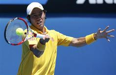 Kei Nishikori of Japan hits a return to Marinko Matosevic of Australia during their men's singles at the Australian Open 2014 tennis tournament in Melbourne January 14, 2014. REUTERS/Jason Reed