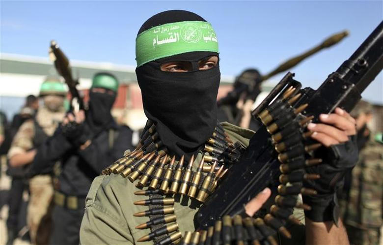 Palestinian members of the al-Qassam brigades, the armed wing of the Hamas movement, stand guard as they wait for the arrival of Hamas chief Khaled Meshaal in Rafah in the southern Gaza Strip in this December 7, 2012 file photograph. REUTERS/Mohammed Salem/Files
