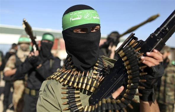 Palestinian members of the al-Qassam brigades, the armed wing of the Hamas movement, stand guard as they wait for the arrival of Hamas chief Khaled Meshaal in Rafah in the southern Gaza Strip in this December 7, 2012 file photograph. REUTERS-Mohammed Salem-Files